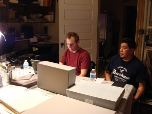 Colin Post and Cornelio Campos working on Cornelio's archival collection.