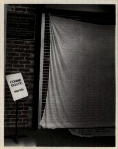 Photo from Bostic's archive depicting the covered wall of her MFA thesis exhibition