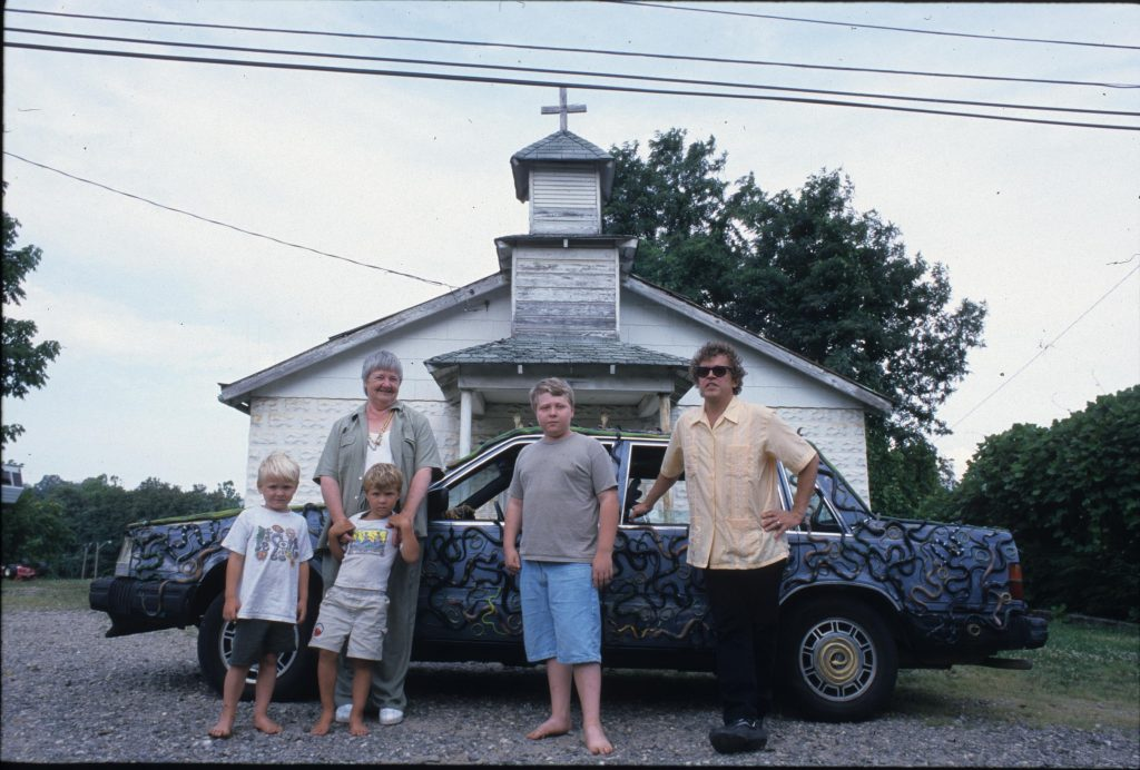 Connie Bostic with Snakemobile and family Digitized from slide c. 2000s